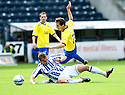KILMARNOCK'S LIAM KELLY IS BUNDLED OVER BY PARS CRAIG EASTON