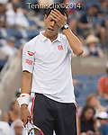 Kei Nishikori (JPN) defeats Stan Wawrinka (SUI) 3-6, 7-5, 7-6, 6-7, 6-4 at the US Open being played at USTA Billie Jean King National Tennis Center in Flushing, NY on September 3, 2014
