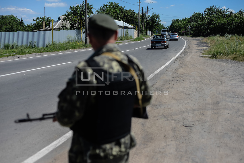 Member of Russian Orthodox Army seen at one of the checkpoints south-east of Donetsk.