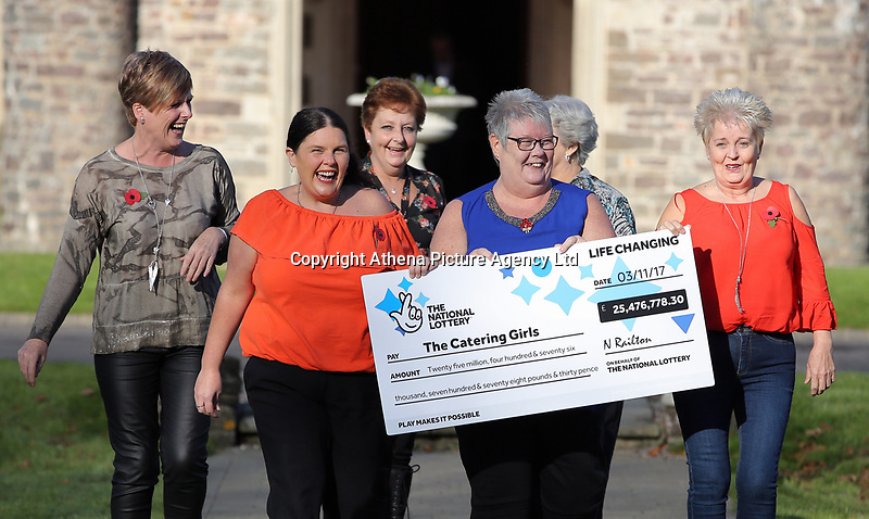 Pictured L-R: Julie Amphlett, Louise Ward, Julie Saunders, Sian Jones, Jean Cairns and Doreen Thompson with the check. Wednesday 08 November 2017<br /> Re: Presentation of hospital catering syndicate win £25m in Euromillions Jackpot at Hensol Castle, south Wales, UK. Julie Saunders, 56, Doreen Thompson, 56, Louise Ward, 37, Jean Cairns, 73, SIan Jones, 54 and Julie Amphlett, 50 all work as catering staff for Neath Port Talbot Hospital in south Wales.