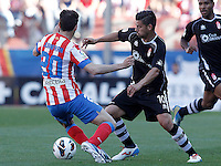 Atletico de Madrid's Juanfran Torres (l) and Granada's Nolito during La Liga match.April 14,2013. (ALTERPHOTOS/Acero)
