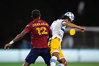 LAKE BUENA VISTA, FL - JULY 27: Douglas Martinez #12 of Real Salt Lake and Oswaldo Alanis #4 of the San Jose Earthquakes battles the ball during a game between San Jose Earthquakes and Real Salt Lake at ESPN Wide World of Sports on July 27, 2020 in Lake Buena Vista, Florida.