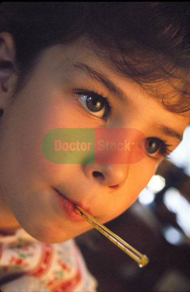 young girl with thermometer in mouth looking ill