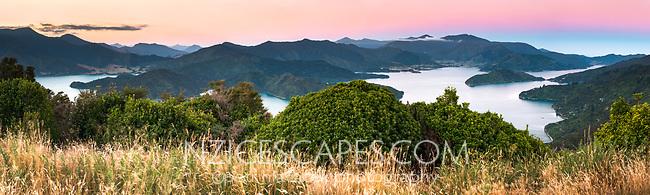Pastel colours of twilight over Kenepuru Sound in Marlborough Sounds with Hikapu Reach on left, Nelson Region, Marlborough, South Island, New Zealand
