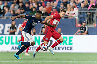 FOXBOROUGH, MA - AUGUST 25: DeJuan Jones #24 of New England Revolution foils a break by Przemyslaw Frankowski #11 of Chicago Fire during a game between Chicago Fire and New England Revolution at Gillette Stadium on August 24, 2019 in Foxborough, Massachusetts.