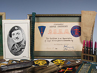BNPS.co.uk (01202 558833)<br /> Pic: LindsayBurns/BNPS<br /> <br /> Pictured: Marine Jock Mathieson's Commando Service Certificate.<br /> <br /> The medals, weapons and personal effects of a hero D-Day commando have sold for over £11,000 - 22 times their estimate.<br /> <br /> Marine Jock Mathieson narrowly escaped death during the Normandy landings on June 6, 1944.<br /> <br /> A bullet pierced the fuel tank of his motorbike which he was carrying above his head while wading through the sea towards Juno Beach.
