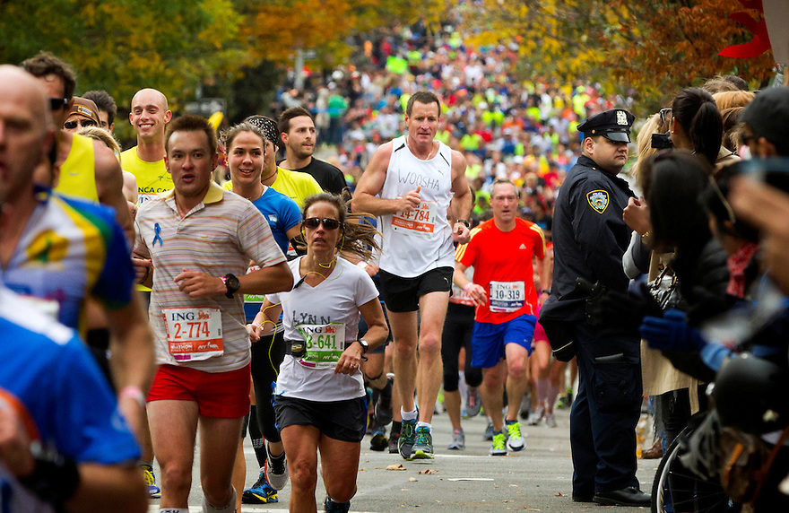 Former West Coast coach and AFL legend John Worsfold runs along Bedford avenue in the Brooklyn neighbourhood of Williamsburg near the halfway point of the New York Marathon.