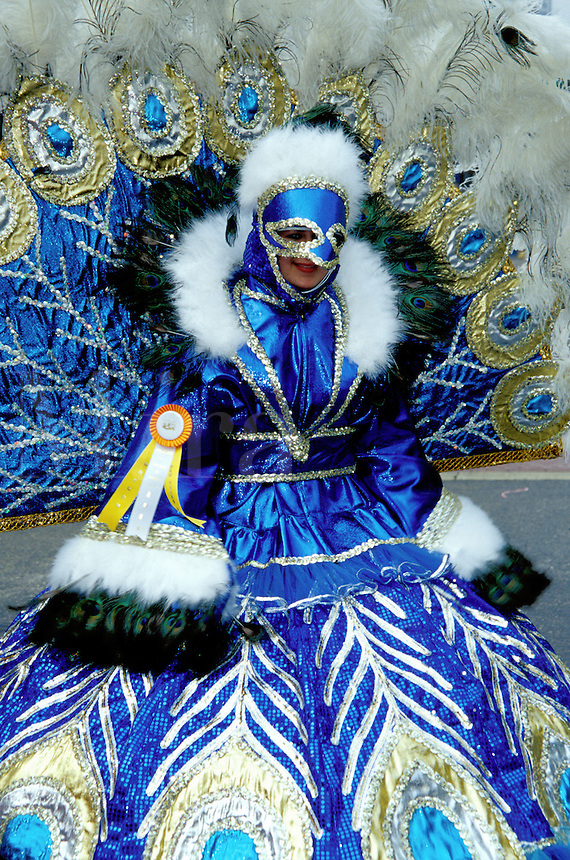 costume, parade, Philadelphia, PA, Pennsylvania, A woman in the Fancy Division is dressed in a costume of blue feathers in the Mummers Day Parade on New Years Day in Philadelphia.