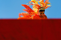 A Colombian girl, having an orange feather costume, performs on the top of the allegorical float during the Carnival in Barranquilla, Colombia, 25 February 2006. The Carnival of Barranquilla is a unique festivity which takes place every year during February or March on the Caribbean coast of Colombia. A colourful mixture of the ancient African tribal dances and the Spanish music influence - cumbia, porro, mapale, puya, congo among others - hit for five days nearly all central streets of Barranquilla. Those traditions kept for centuries by Black African slaves have had the great impact on Colombian culture and Colombian society. In November 2003 the Carnival of Barranquilla was proclaimed as the Masterpiece of the Oral and Intangible Heritage of Humanity by UNESCO.