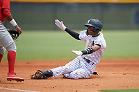 GCL Yankees East Alexander Vargas (12) slides into third base during a Gulf Coast League game against the GCL Phillies West on July 26, 2019 at the New York Yankees Minor League Complex in Tampa, Florida.  (Mike Janes/Four Seam Images)