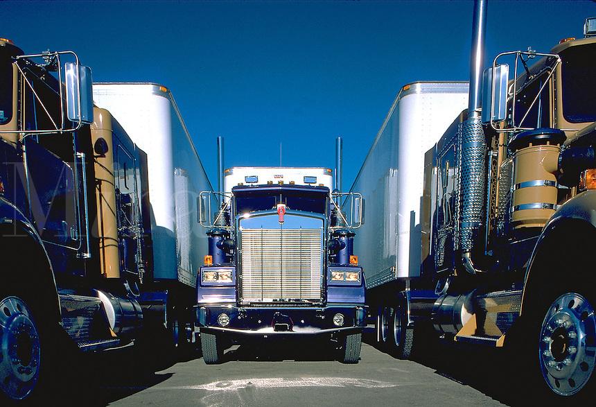 """3 large 18 wheel trucks or """"semis"""", Mack trucks. United States."""