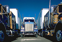 "3 large 18 wheel trucks or ""semis"", Mack trucks. United States."