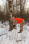 Wisconsin hunter checking trail camera