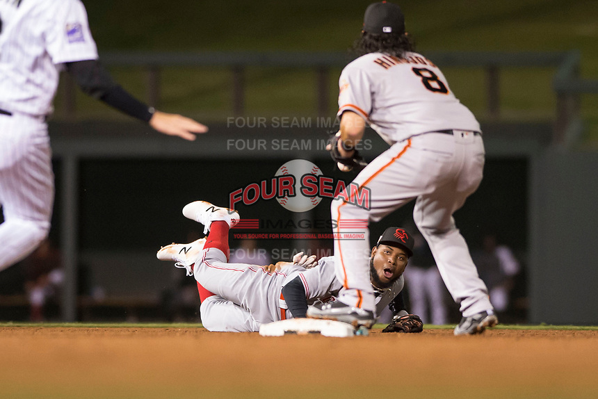 Scottsdale Scorpions shortstop Alfredo Rodriguez (3), of the Cincinnati Reds organization, flips a ball to C.J. Hinojosa (8) after making a diving stop to start a double play during an Arizona Fall League game against the Salt River Rafters at Salt River Fields at Talking Stick on October 11, 2018 in Scottsdale, Arizona. Salt River defeated Scottsdale 7-6. (Zachary Lucy/Four Seam Images)