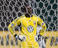 D.C. United goalkeeper Bill Hamid  stands in the net after being given a red card during the game at RFK Stadium in Washington, DC.  D.C. United tied Toronto FC, 3-3.