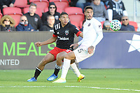 WASHINGTON, DC - MARCH 07: Edison Flores #10 of D.C. United battles the ball with Nicolas Figal #5 of Inter Miami CF during a game between Inter Miami CF and D.C. United at Audi Field on March 07, 2020 in Washington, DC.