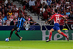 Atletico de Madrid's Rodrigo Hernandez and Club Brugge's Clinton Mata during UEFA Champions League match between Atletico de Madrid and Club Brugge at Wanda Metropolitano Stadium in Madrid, Spain. October 03, 2018. (ALTERPHOTOS/A. Perez Meca)