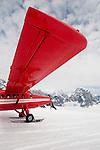 Side View of a DeHavilland Turbine Otter Skiplane in Alaska, on Ruth Glacier near Mt McKinley