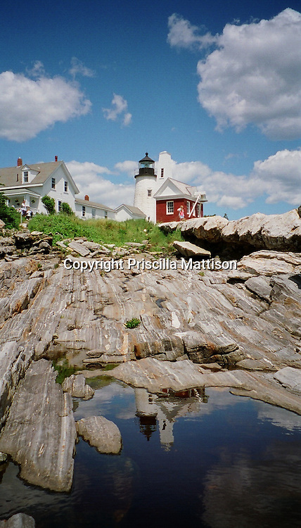 A rock pool in Bristol, Maine reflects the Pemaquid Point Lighthouse above.  This image was published in the Philadelphia Inquirer in October, 1998.