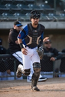 Missoula Osprey catcher Nick Dalesandro (8) jogs onto the field before a Pioneer League game against the Grand Junction Rockies at Ogren Park Allegiance Field on August 21, 2018 in Missoula, Montana. The Missoula Osprey defeated the Grand Junction Rockies by a score of 2-1. (Zachary Lucy/Four Seam Images)