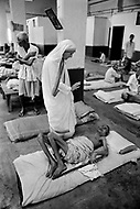 """Calcutta, India. April 04, 1975.<br /> Mother Teresa vists patients at her free hospice for the poor in Calcutta. The first Home for the Dying opened in 1952 and was a free hospice for the poor. Mother Teresa (Agnes Gonxha Boyaxihu) the Roman Catholic, Albanian nun revered as India's """"Saint of the Slums,"""" was awarded the 1979 Nobel Peace Prize."""