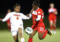 BOYDS, MARYLAND - April 06, 2013:  Jasmyne Spencer (20) of The Washington Spirit goes for the ball with Morgan Stith (4) of the University of Virginia women's soccer team in a NWSL (National Women's Soccer League) pre season exhibition game at Maryland Soccerplex in Boyds, Maryland on April 06. Virginia won 6-3.