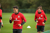 Pictured: Joe Allen (R) and Neil Taylor warm up. Monday 02 October 2017<br /> Re: Wales football training, ahead of their FIFA Word Cup 2018 qualifier against Georgia, Vale Resort, near Cardiff, Wales, UK.