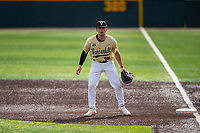 Vanderbilt Commodores first baseman Dominic Keegan (12) on defense against the Tennessee Volunteers on Robert M. Lindsay Field at Lindsey Nelson Stadium on April 17, 2021, in Knoxville, Tennessee. (Danny Parker/Four Seam Images)