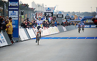 World Champion  Marianne Vos (NLD/Rabo-Liv) crossing the finish line victoriously<br /> <br /> Zolder CX UCI World Cup 2014