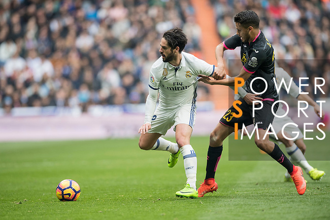 Isco Alarcon of Real Madrid  fights for the ball with Diego Reyees of RCD Espanyol during the match Real Madrid vs RCD Espanyol, a La Liga match at the Santiago Bernabeu Stadium on 18 February 2017 in Madrid, Spain. Photo by Diego Gonzalez Souto / Power Sport Images