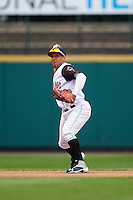 Rochester Red Wings shortstop Wilfredo Tovar (4) throws to first during a game against the Toledo Mudhens on June 12, 2016 at Frontier Field in Rochester, New York.  Rochester defeated Toledo 9-7.  (Mike Janes/Four Seam Images)