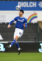 20th March 2021; Liberty Stadium, Swansea, Glamorgan, Wales; English Football League Championship Football, Swansea City versus Cardiff City; Kieffer Moore of Cardiff City jumps for the header