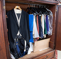 BNPS.co.uk (01202 558833)<br /> Pic: PhilYeomans/BNPS<br /> <br /> The house still contain's wardrobe's full of his clothes.<br /> <br /> A remarkable 'timewarp' archive amassed by a dressmaker to the Queen has sold for over £100,000.<br /> <br /> The late Ian Thomas meticulously kept his fashion designs, letters, cards and photographs relating to the Queen at his home that was more like a museum. <br /> <br /> He helped design the Queen's coronation gown in 1953 as well as the powder blue outfit she wore for Charles and Diana's wedding in 1981.<br /> <br /> The lifelong bachelor passed away in 1993 and left his home and its contents to a florist he had been good friends with for 25 years.<br /> <br /> After she died in 2015 the property was inherited by a relative who also knew Mr Thomas well.<br /> <br /> She has now sold the contents at auction.