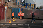 """Portsmouth 1 Southampton 1, 18/12/2012. Fratton Park, Championship. Stewards on patrol outside Fratton Park stadium before Portsmouth take on local rivals Southampton in a Championship fixture. Around 3000 away fans were taken directly to the game in a fleet of buses in a police operation known as the """"coach bubble"""" to avoid the possibility of disorder between rival fans. The match ended in a one-all draw watched by a near capacity crowd of 19,879. Photo by Colin McPherson."""