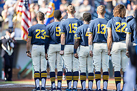 Michigan Wolverines line up for the National Anthem before Game 3 of the NCAA College World Series Finals on June 26, 2019 at TD Ameritrade Park in Omaha, Nebraska. Vanderbilt defeated Michigan 8-2 to win the National Championship. (Andrew Woolley/Four Seam Images)