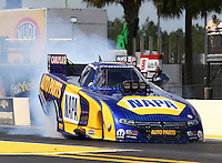 Mar 13, 2015; Gainesville, FL, USA; NHRA funny car driver Ron Capps during qualifying for the Gatornationals at Auto Plus Raceway at Gainesville. Mandatory Credit: Mark J. Rebilas-