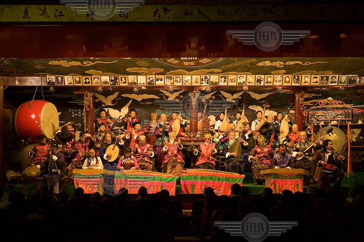 The ethnic Nakhi (Naxi) orchestra during their musical performance for tourists. Many of the traditions of Nakhi culture are kept alive through institutions such as musical recitals.