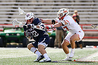 College Park, MD - February 15, 2020: Penn Quakers attack Sean Lulley (22) gets pushed by Maryland Terrapins defender Brett Makar (43) during the game between Penn and Maryland at  Capital One Field at Maryland Stadium in College Park, MD.  (Photo by Elliott Brown/Media Images International)