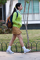 Cuba, Havana.   Cuba's Young Generation.  Teenage Girl going to School.  Ochre-yellow pants or skirt indicate secondary school level.