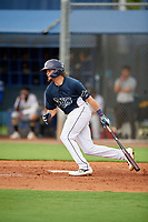 GCL Rays Dawson Dimon (14) bats during a Gulf Coast League game against the GCL Pirates on August 7, 2019 at Charlotte Sports Park in Port Charlotte, Florida.  GCL Rays defeated the GCL Pirates 5-3 in the second game of a doubleheader.  (Mike Janes/Four Seam Images)