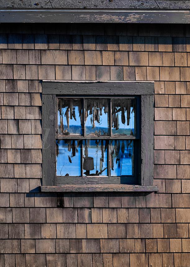 Hooks and lures in a fishing shack window, Menemsha, Chilmark, Martha's Vineyard, Massachusetts, USA.