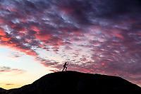 Female runner, hoping across skyline during spectacular sunset, West Sweden, Sweden - Västsverige, Sverige