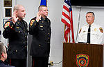 WOLCOTT, CT-122117JS07---Wolcott Police Chief Edward Stephens, right, looks on as Wolcott police officers Leonard Greene, left, and Patrick Malloy, center, are promoted to the rank of lieutenants during a ceremony Thursday at the police headquarters. In their duties, they will be splitting the responsibilities of Capt. Domenic Angiolillo, who retired earlier this year. Malloy will oversee the patrol division and Greene will head the detectives bureau. <br /> Jim Shannon Republican-American
