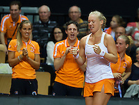 Arena Loire,  Trélazé,  France, 16 April, 2016, Semifinal FedCup, France-Netherlands, First match: Kiki Bertens vs Caroline Garcia, Kiki Bertens (NED) is congratulated by her team members Arantxa Rus (L) team manager Guus van Berkel and Richel Hogenkamp<br /> Photo: Henk Koster/Tennisimages