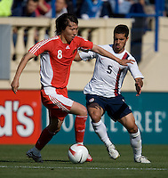 Li Tie holds off Benny Feilhaber. The USA defeated China, 4-1, in an international friendly at Spartan Stadium, San Jose, CA on June 2, 2007.