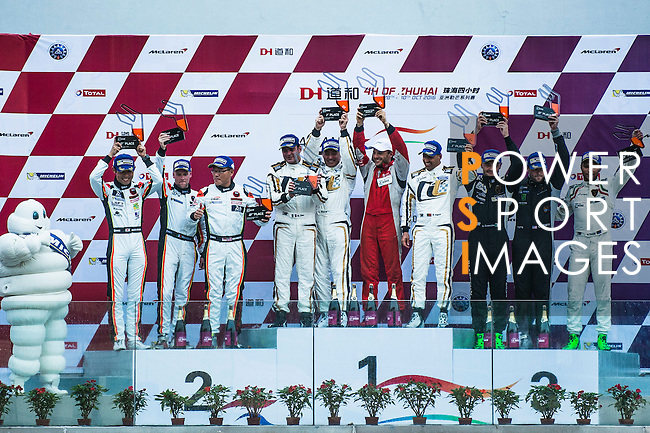Ferrari 488 GT3' drivers Narsat Muzayyin, Rui Aguas and Marco Cioci celebrate the victory of GT Class during the 2016-2017 Asian Le Mans Series Round 1 at Zhuhai Circuit on 30 October 2016, Zhuhai, China.  Photo by Marcio Machado / Power Sport Images