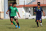 """Palestinian football players of Alsadaqa club (green) and Al Hilal club (Dark blue) compete during the """"4"""" Tokyo Championship, born in 2004-2003, the Gaza and North Final, at Palestine Stadium in Gaza City, on April 5, 2021. Photo by Marihan Al-Khalidi"""