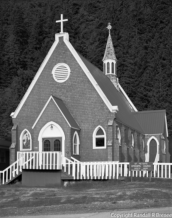 """""""Saint Peter's Episcopal Church""""<br /> Seward, Alaska<br /> <br /> The Kenai Peninsula, located just south of Anchorage, offers visitors an enormous number of natural and cultural activities. I enjoyed an evening at Thorn's Showcase Lounge in Seward where I drank a few beverages while gorging on a """"Bucket of But"""" (halibut, that is). The next morning I photographed Seward's St. Peter's Episcopal Church as my way of seeking forgiveness for my indulgence the previous evening. The church was set against a terrific backdrop and looked beautiful in the morning light."""