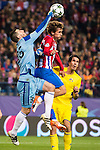 Antoine Griezmann of Atletico de Madrid battles for the ball with goalkeeper Soslan Dzhanaev of FC Rostov during their 2016-17 UEFA Champions League match between Atletico Madrid and FC Rostov at the Vicente Calderon Stadium on 01 November 2016 in Madrid, Spain. Photo by Diego Gonzalez Souto / Power Sport Images