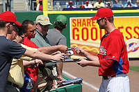 Philadelphia Phillies pitcher Kyle Kendrick #38 signs autographs before a scrimmage against the Florida State Seminoles at Brighthouse Field on February 29, 2012 in Clearwater, Florida.  Philadelphia defeated Florida State 6-1.  (Mike Janes/Four Seam Images)
